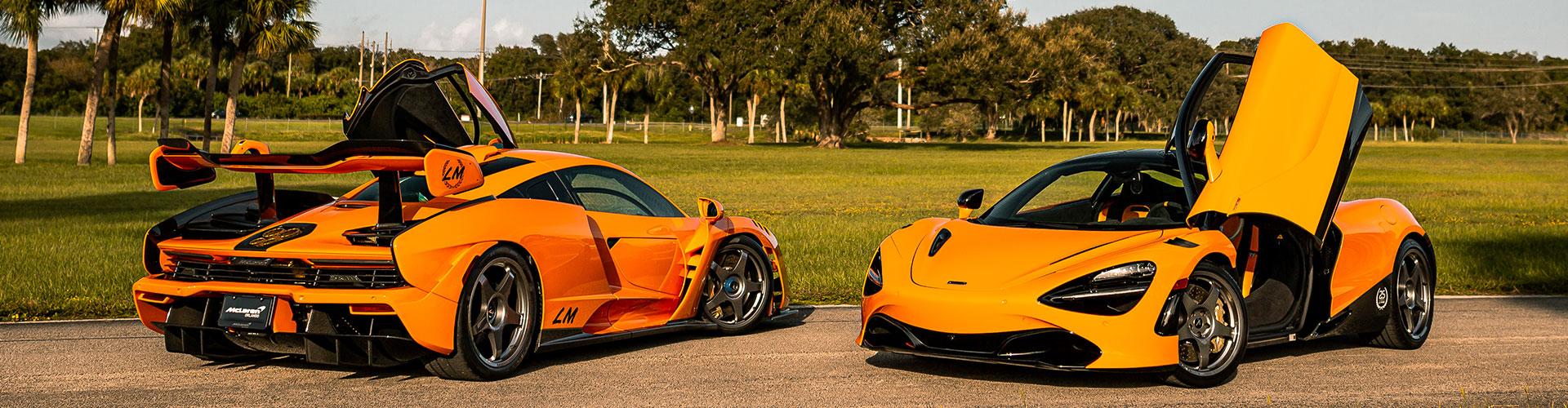 McLaren Vehicles with drivers side door open. Le Mans Victory